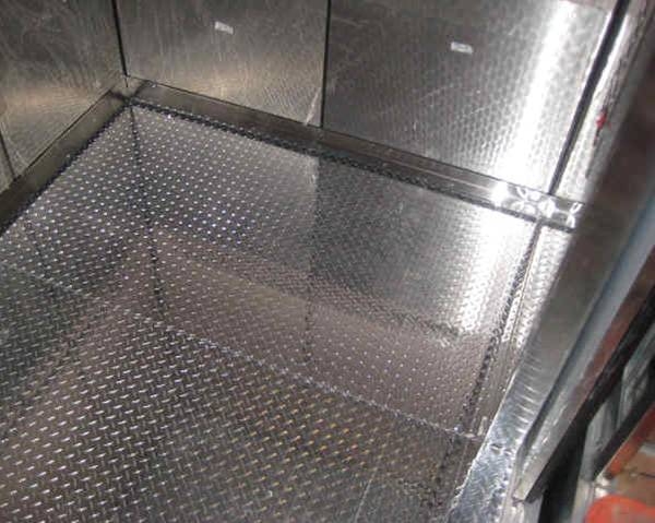 The flooring of elevator is covered by the galvanized checker plate.