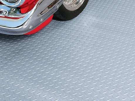 A Car Is Parking On The Checker Plate Flooring.