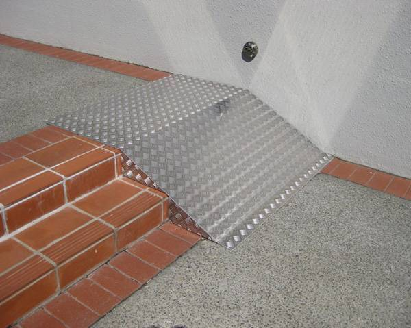 The ramp of stair treads are covered with aluminum checker plate.