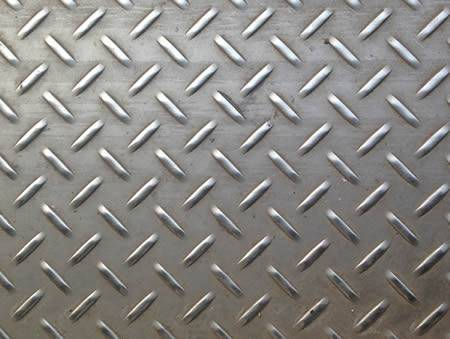 A piece of stainless steel checker plate with raised short willow leaf projections.