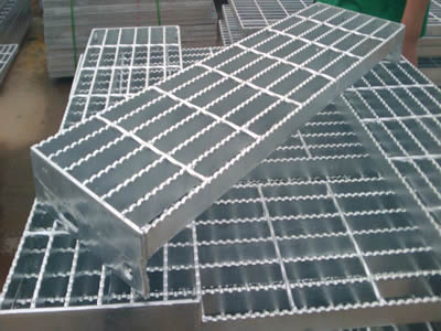 Many welded steel grating stair treads without nosing.