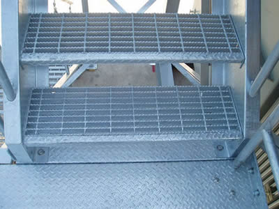 Steel grating stair treads for indoor application.