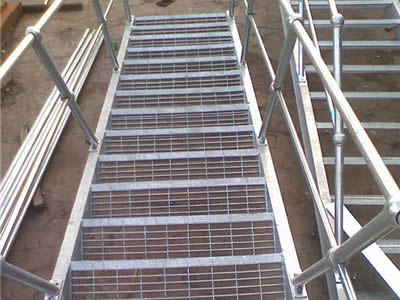 Steel grating stair treads for outdoor application.
